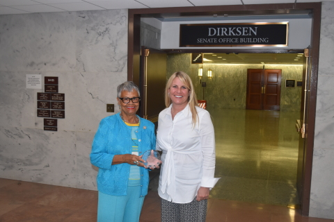 Representative Bonnie Watson Coleman (D-NJ) receives the Navigator Award from GBTA President Christle Johnson (Photo: Business Wire)