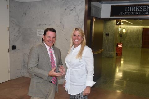 Representative Sam Graves (R-MO) receives the Navigator Award from GBTA President Christle Johnson (Photo: Business Wire)