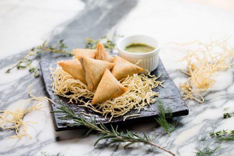 Crispy Impossible Samosas with mint chutney at Hotel ICON's GREEN (Photo: Business Wire)