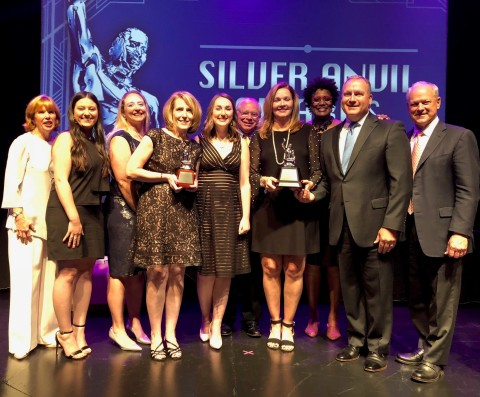 Members of the BlueCross BlueShield of Tennessee, BlueCross BlueShield of Tennessee Health Foundation and MP&F Strategic Communications teams accept the 2018 Best of Silver Anvil Award from master of ceremonies Nancy Giles, third from right. Left to right: Katy Varney, Angela Argiro, Chelsea Johnson, Mary Danielson, Laura Haynes, Mark McNeely, Jennifer Brantley, Nancy Giles, Roy Vaughn and David Fox (Photo: Business Wire)