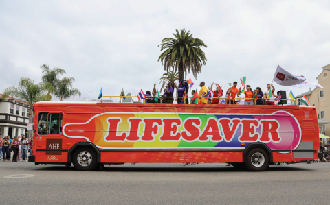 "AHF's choice of ""Lifesaver"" art and messaging for its Pride participations in Los Angeles/West Hollywood and nationwide underscores the urgent need for a return to promotion and use of condoms as an effective tool for HIV and STD prevention. (Photo: Business Wire)"