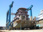 A steel tug sits on the 660-ton Travelift at Metal Shark's newly-acquired Alabama Shipyard, formerly the home of Horizon Shipbuilding.  (Photo: Business Wire)