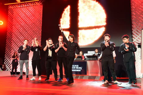 In this photo provided by Nintendo of America, Super Smash Bros. Ultimate Director Masahiro Sakurai (with microphone) takes the stage with players before they battle it out in the Super Smash Bros. Invitational 2018 tournament on Tuesday, June 12, 2018, at the Belasco Theater in Los Angeles. The upcoming game for the Nintendo Switch system features every fighter the series has ever known. (Photo by Jordan Strauss/Invision for Nintendo/AP Images)