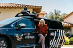 Another happy client alights from one of the many autonomous vehicles in the fleet. (Photo: Business Wire)