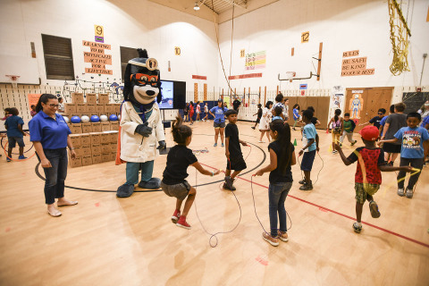 "Members of Boys & Girls Clubs of the Austin Area were led through exercises with UnitedHealthcare mascot Dr. Health E. Hound to test their new NERF ENERGY Game Kits that track activity earning ""energy points"" in order to play the game. Today's donation of 100 kits is part of a national initiative between Hasbro and UnitedHealthcare, featuring Hasbro's NERF products, that encourages young people to become more active through ""exergaming"" (Photo: Kevin Vandivier)."