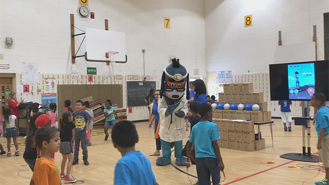 "Members of Boys & Girls Clubs of the Austin Area were led through exercises with UnitedHealthcare mascot Dr. Health E. Hound to test their new NERF ENERGY Game Kits that track activity earning ""energy points"" in order to play the game. Today's donation of 100 kits is part of a national initiative between Hasbro and UnitedHealthcare, featuring Hasbro's NERF products, that encourages young people to become more active through ""exergaming"" (Video: Anita Sen)."