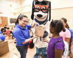 """UnitedHealthcare donated 100 NERF Energy Game Kits to Boys & Girls Clubs of the Austin Area as part of a national initiative to encourage young people to become more active through """"exergaming."""" Marian Cabanillas of UnitedHealthcare distributed kits to the members earlier today. The donation is part of a recently launched national initiative between Hasbro and UnitedHealthcare, featuring Hasbro's NERF products, that encourages young people to become more active through """"exergaming"""" (Photo: Kevin Vandivier)."""