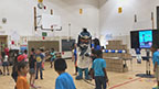"""Members of Boys & Girls Clubs of the Austin Area were led through exercises with UnitedHealthcare mascot Dr. Health E. Hound to test their new NERF ENERGY Game Kits that track activity earning """"energy points"""" in order to play the game. Today's donation of 100 kits is part of a national initiative between Hasbro and UnitedHealthcare, featuring Hasbro's NERF products, that encourages young people to become more active through """"exergaming"""" (Video: Anita Sen)."""