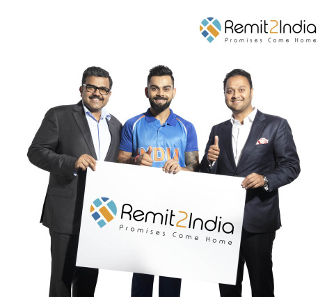Indian Cricket Captain Virat Kohli with Finablr Executive Director Binay Shetty (right) and Finablr Executive Director Promoth Manghat (left). (Photo: AETOSWire)