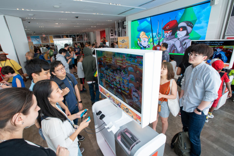 In this photo provided by Nintendo of America, fans gather at the Nintendo NY store in Rockefeller Plaza to celebrate International Sushi Day by eating sushi and playing the new Sushi Striker: The Way of Sushido game. An action-packed puzzle game that's all about matching plates and eating sushi, Sushi Striker: The Way of Sushido is now available for the Nintendo Switch system and in 2D for the Nintendo 3DS family of systems. A free demo is also available in Nintendo eShop on Nintendo Switch – perfect for International Sushi Day on June 18! (Photo: Business Wire)