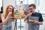 In this photo provided by Nintendo of America, Madison M., age 17, and Jackson M., age 13, celebrate International Sushi Day during a special event at the Nintendo NY store in Rockefeller Plaza by enjoying delicious sushi – just like the main character in the new Sushi Striker: The Way of Sushido game. An action-packed puzzle game that's all about matching plates and eating sushi, Sushi Striker: The Way of Sushido is now available for the Nintendo Switch system and in 2D for the Nintendo 3DS family of systems. A free demo is also available in Nintendo eShop on Nintendo Switch – perfect for International Sushi Day on June 18! (Photo: Business Wire)