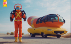Super Hotdogger stands next to the vehicle that first ignited the brand's mission of delivering a better Oscar Mayer Hot Dog, the Wienermobile. (Photo: Business Wire)
