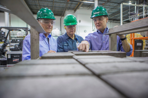 Solidia Technologies® CTO Nick DeCristofaro (left) and CEO Tom Schuler (right) inspect Solidia Concrete™ CO2-cured pavers. (Photo credit: Marc Morrison)