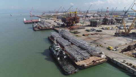 The first modules built at the COOEC-Fluor fabrication yard in Zhuhai, China, were shipped in May an ...