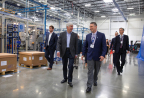 Cosworth facility General Manager Ken Gembel shows Gov. Snyder around the new advanced manufacturing facility. (Photo: Business Wire)