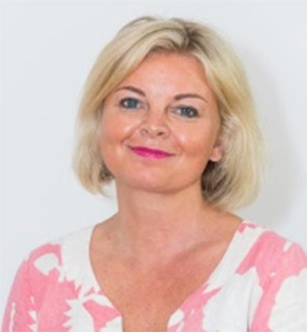 Carolyn Chamberlain (Photo: Business Wire)