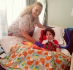 Lallafaye Mata, a licensed vocational nurse, at left, cares for 5-year-old patient Junior Reyes in the pediatric subacute unit at Foothill Regional Medical Center. (Photo: Business Wire)