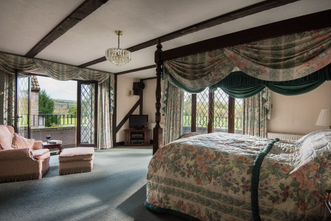 One of the bedrooms at the Millionaire Mansion, England. (Photo: Business Wire)