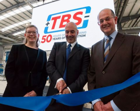 Tom Valvo, MiTek Industries Chief Operating Officer cuts the ribbon at the opening ceremony of TBS Engineering's new £15m HQ in the UK. From left to right: Viv Empson, TBS Group Finance and HR Director; Tom Valvo, MiTek Industries COO; and David Longney, TBS Group Managing Director. (Photo: Business Wire)