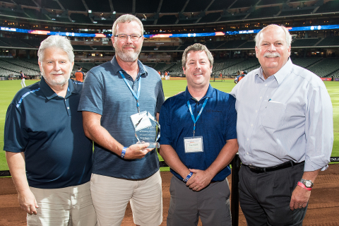 Pictured, from left, Bill Justus, vice president of supply chain services for David Weekley Homes; Michael Murphy, national accounts manager for LP; Tom Smith, national accounts manager for LP; and David Weekley. (Photo: Business Wire)