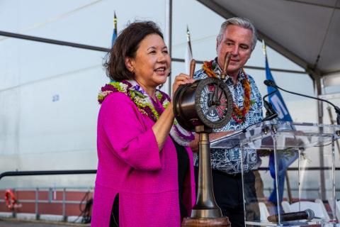 Ship sponsor, Irene Hirano Inouye, Senator Inouye's wife, christens the vessel by breaking a ceremon ...