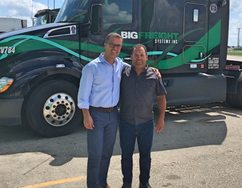 Gary Coleman, president of Big Freight Systems, and Jim Clunie, president of Kelsey Trail Trucking, believe the merger of their second-generation trucking companies is a great match because of their shared long family history and success in trucking. (Photo: Business Wire)