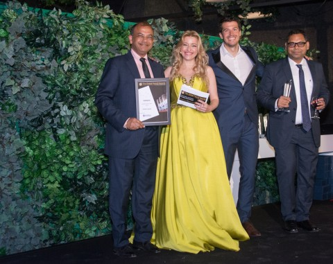 Global Upside CEO Ragu Bhargava and Managing Director Rohit Lohia accept the Global Payroll Team of the Year award. (Photo: Business Wire)