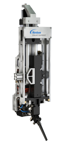 Designed for sealant dispensing applications in aerospace manufacturing, the robot mounted JetStream™ system features an articulating cartridge holder that opens to load and unload pre-mixed cartridges. Its built-in volumetric dispense valve assembly eliminates material supply hoses and increases the accuracy of bead, volume and placement through automation. (Photo: Business Wire)