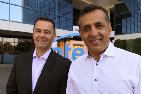 Dan McNamara (left), corporate vice president and general manager of Intel's Programmable Solutions Group, stands with eASIC CEO, Ronnie Vasishta, outside Intel Corporation headquarters in Santa Clara, California. Intel on Thursday, July 12, 2018, announced plans to acquire custom chipmaker eASIC. (Credit: Intel Corporation)