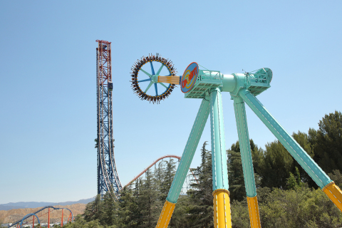 """Six Flags Magic Mountain, the undisputed """"Thrill Capital of the World,"""" today debuted CraZanity, the world's tallest and fastest pendulum ride. At a record-breaking 170-feet in the air, the massive giant disk reaches speeds up to 75 miles-per-hour, as it whips back and forth - higher and higher, giving riders a staggering view of the world below them. (Photo: Business Wire)"""