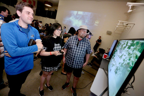 In this photo provided by Nintendo of America, fans play Octopath Traveler on the Nintendo Switch at the iam8bit Gallery Octopath Traveler launch celebration in Los Angeles. Octopath Traveler is now available in Nintendo eShop on Nintendo Switch and is available at retailers on July 13.