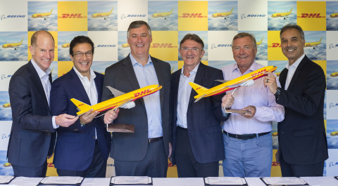 From left to right: Kevin McAllister CEO Boeing Commercial Airplanes; Ihssane Mounir, VP Sales & Marketing The Boeing Company; Dan Abraham, VP Sales Europe Boeing Commercial Airplanes; Ken Allen, CEO DHL Express; Charlie Dobbie, COO DHL Express; Mike Parra, CEO DHL Express Americas.  (Photo: Business Wire)