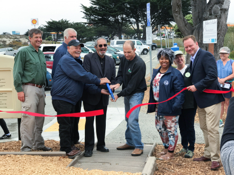 Seaside Mayor Ralph Rubio (Center) cuts a ribbon to a new eco-park in the city along with other city representatives and California American Water Vice President Kevin Tilden (Right).(Photo: Business Wire)