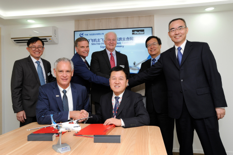 Parker Aerospace and AVIC executives sign the agreement for flight controls on the MA700 aircraft at Farnborough Air Show (Photo: Business Wire)