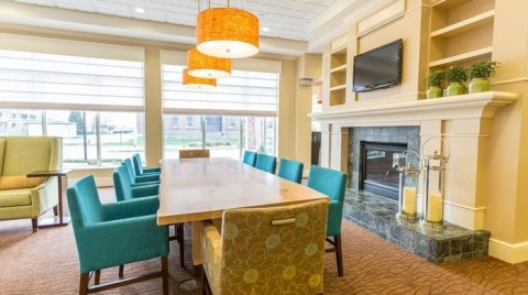Family-size tables welcome groups in the lobby. (Photo: Business Wire)