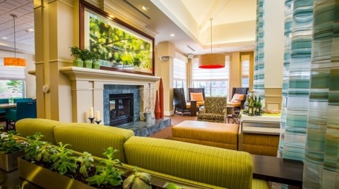 A fireplace warms the hotel lobby. (Photo: Business Wire)
