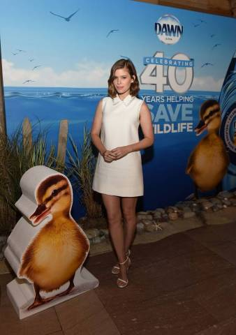 Kate Mara poses among a 3D exhibit in Grand Central Terminal celebrating Dawn's 40 years of helping save wildlife, Thursday, July 19, 2018, in New York. Dawn has helped save more than 75,000 birds and marine animals along with wildlife partners International Bird Rescue and The Marine Mammal Center. (Photo by Diane Bondareff/Invision for Dawn/AP Images)