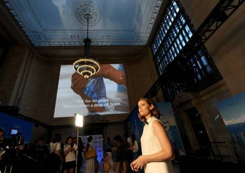 Kate Mara watches as 75,000 3D projected birds soar overhead to celebrate Dawn's 40 years of helping save wildlife, Thursday, July 19, 2018, at Grand Central Terminal in New York. Dawn has been leading the way to a better world by helping save wildlife and supporting the organizations dedicated to rescuing and rehabilitating wildlife when disaster strikes, including International Bird Rescue and The Marine Mammal Center. (Photo by Diane Bondareff/Invision for Dawn/AP Images)