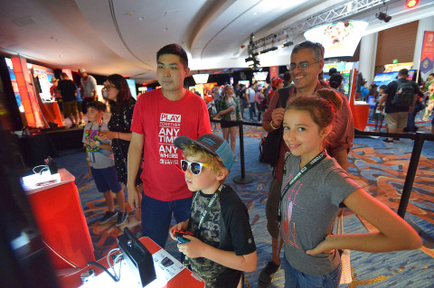 In this photo provided by Nintendo of America, a family competes in the ultimate family-fun battle with Donkey Kong Country: Tropical Freeze at the Nintendo Gaming Lounge during San Diego Comic-Con 2018. Donkey Kong Country: Tropical Freeze is available now on the Nintendo Switch System.