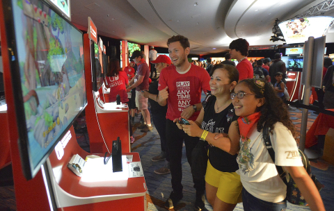 In this photo provided by Nintendo of America, a mother and daughter team up to climb the Donkey Kong Country: Tropical Freeze leaderboards at the Nintendo Gaming Lounge at the Marriott Marquis and Marina. Donkey Kong Country: Tropical Freeze is available now on the Nintendo Switch System.