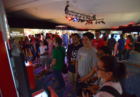 In this photo provided by Nintendo of America, fans get an early hands-on demo of the Super Smash Bros. Ultimate game during San Diego Comic-Con 2018. Super Smash Bros. Ultimate launches on Dec. 7 exclusively for the Nintendo Switch system.