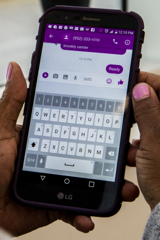 "Using Hitch Health, Sandra Harris texts ""Ready"" to her Lyft driver after her doctor's appointment in Minneapolis, Minn. (Photo: Business Wire)"