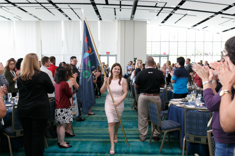 Synchrony has its Fourth Annual Diversity Symposium and starts the event with Marissa Lara, SVP, Chief Diversity & Corporate Responsibility Officer, carrying a flag to celebrate the power of diversity. (Photo: Business Wire)