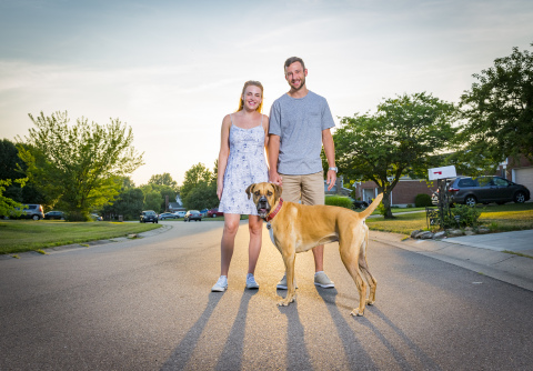 R.J. Leppert (pictured with his girlfriend Jenna Pierce and dog, Tucker) uses the Fifth Third Momentum app to help pay down his student loan debt. He says making an extra payment each month gets him closer to paying his loans off earlier. (Photo: Business Wire)