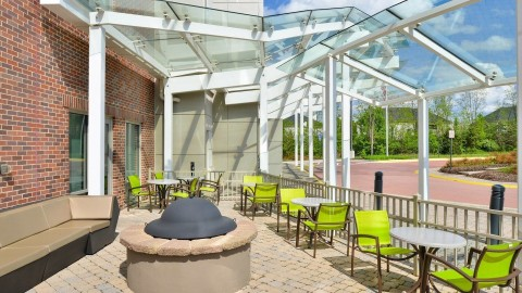 Guests can sip wine and chat by the fire pit. (Photo: Business Wire)