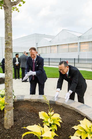 Valent Group Companies President, Andy Lee, and Sumitomo Chemical Company Health & Crop Sciences President, Ray Nishimoto, plant a tree to signify future prosperity for the companies' biorational segment. (Photo: Business Wire)