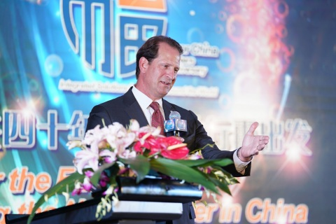 Fluor Chairman & CEO David Seaton addresses employees and suppliers at Fluor China's 40th anniversar ...