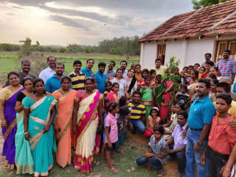 Executives from ELM Solutions traveled to India to participate in the inaugural events, which included the donation and planting of trees and school bags for every child. (Photo: Wolters Kluwer)