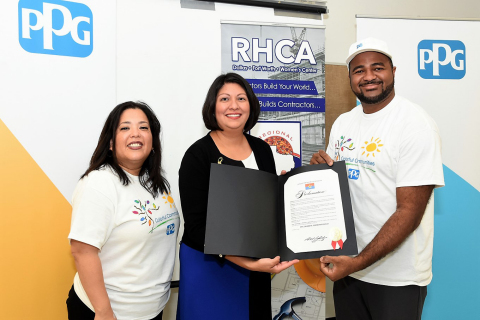 """Councilmember Omar Narvaez's Assistant, Laura Cadena, issued a special proclamation commemorating July 26, 2018 """"PPG Colorful Communities Day"""" in Dallas, Texas. From left to right – Melissa Gonzalez, principal at Lorenzo De Zavala Elementary School; Laura Cadena, Assistant to Councilmember Omar Narvaez; Okey Maduka, PPG sales manager, architectural coatings. (Photo: Business Wire)"""