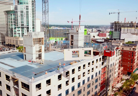 Prefabricated and prefinished exterior wall panels were used to build SOVA Apartments to alleviate c ...